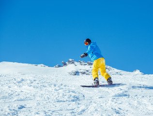 Snowboarder at the winter resort