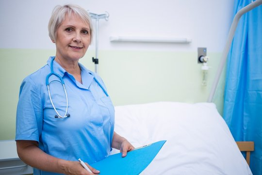 Portrait of nurse holding file