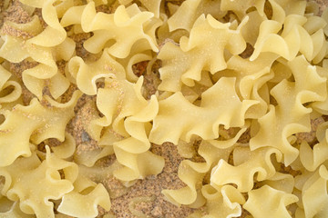 Close view of pasta with seasonings.