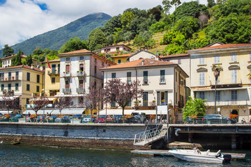 View of many houses at Como lake, Lenno, Italy. Summer sunny day.