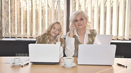 mother and daughter in office