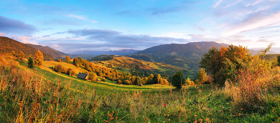 September rural scene in mountains. Autumn hill panorama