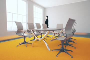 Businessman in bright conference room
