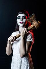 Portrait Halloween dead face girl and ax