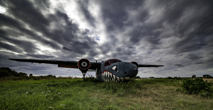 Old aircraft with shark nose.