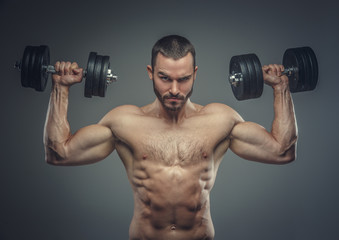 Male doing biceps workouts with dumbbells.