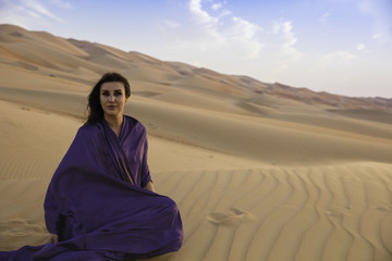 Anna taking a rest on a Dune in the Empty Quarter Desert