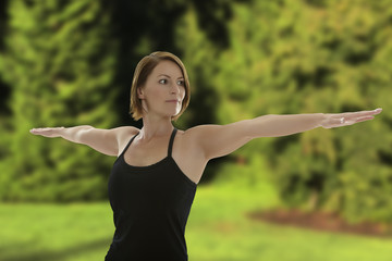 Woman doing Yoga Asana Warrior Pose