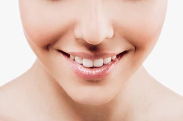 Woman beauty lips, smile teeth portrait isolated on white with healthy skin teeth. Studio shot.