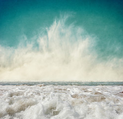 Wall Mural - Fog and Surf. Ocean waves with fog rising at the horizon.  Image displays a pleasing grain texture at 100 percent.