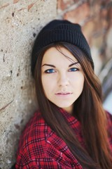 Portrait of a beautiful teen girl with blue eyes, wearing  red s