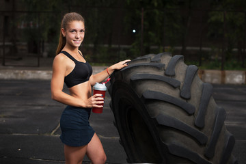 Girl with a shaker. The concept of sports nutrition