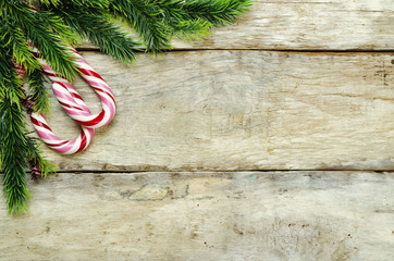 wood background with Christmas tree, candy