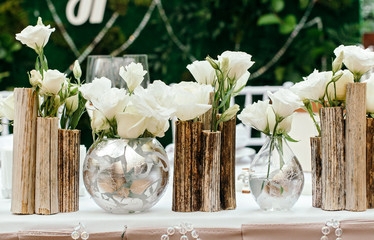 Beautiful decor at the wedding. The flowers on the background of the boards. Close-Up