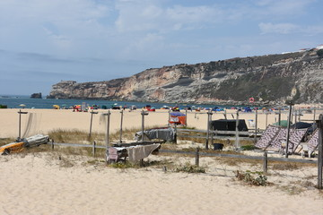 Drying fish on the beach at Nazare fishing village in Portugal