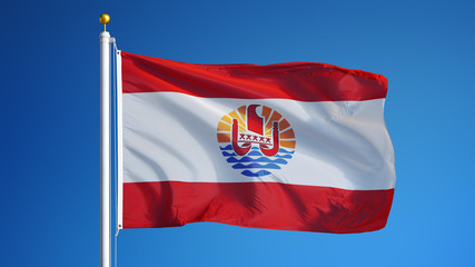 French Polynesia flag waving against clean blue sky, close up, isolated with clipping path mask alpha channel transparency