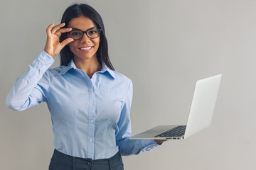 Beautiful business lady with gadget