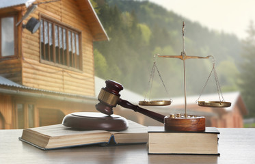 Gavel on blurred house background