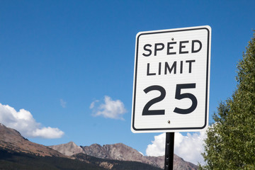 Speed limit sign over mountains in Colorado
