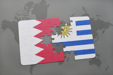 puzzle with the national flag of bahrain and uruguay on a world map background.