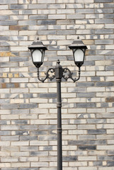 old fashioned street lamp against brick wall