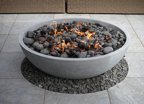 modern fire pit in backyard patio