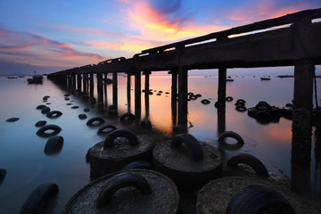 Silhouette natural background of jetty during time the sunset and the beautiful natural of the colorful sky at Bang Phra beach , Chonburi province in Thailand