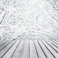 Empty wooden  table for product display with frozen snowy forest