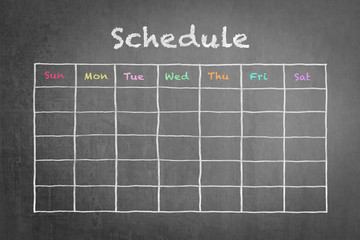 Timetable schedule on black chalkboard background