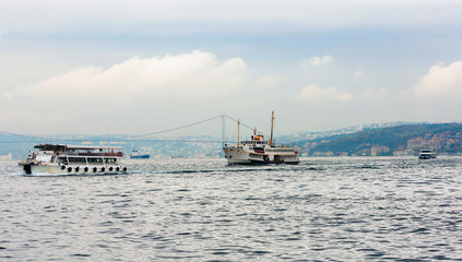Trade ships in the waters of the Bosphorus, Istanbul. Turkey.