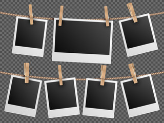 Retro photo frames hanging on rope isolated checkered transparent background vector illustration