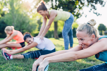 Women stretching workout in the park