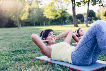 Happy woman doing crunches