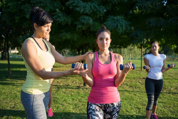Young woman training with personal trainer