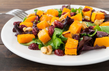 Autumn salad with roasted butternut squash, cranberry and walnut
