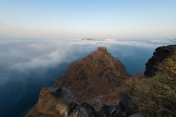 Skaros rock surrounded by clouds | Santorini