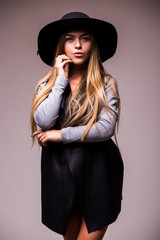 Beautiful young woman wearing summer black hat with large brim