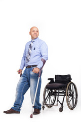 Wheelchair user gets up, moves away from the wheelchair and takes a step on crutches.