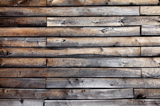 Old brown weathered distressed wood planks background