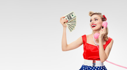 woman with money, talking on phone, dressed in pin-up style dres