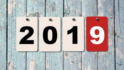2019 calendar plates on wooden wall, represents the new year 2019