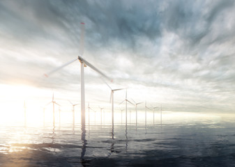 Offshore wind turbines with sunset stormy sky in background