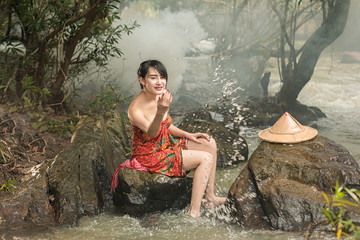 Young people are bathing in waterfall at rural,Thailand.