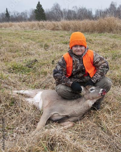 Wall mural Young Deer hunter