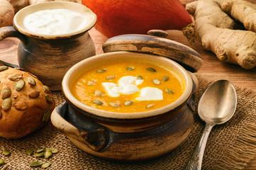 Pumpkin cream soup with ginger and pumpkin seeds.