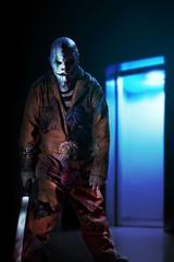 mad killer clown in Halloween horror house