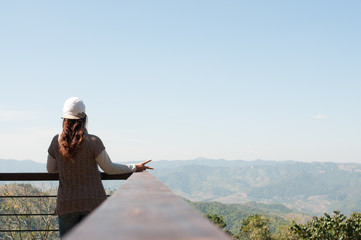 Beautiful young woman on the observation deck in Doi Wawee Chian