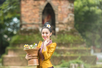 Asian Woman dressed in traditional costume in temple, Thailand .