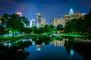 The Uptown skyline and a lake at Marshall Park at night, in Char