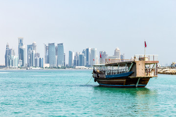 Old Dhow in front of Modern Doha Skyline